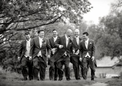 groom-with-groomsen-walking