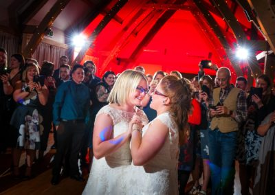 two-brides-dancing-together