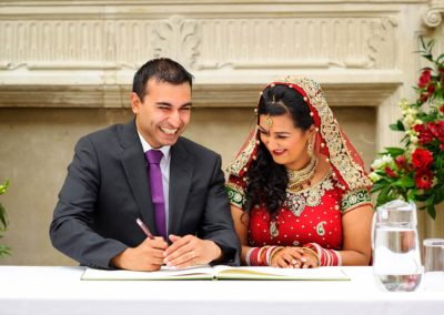 bride-and-groom-signing-register