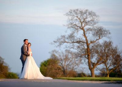 bride-hugging-groom-bassmead-drive
