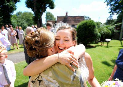 bride-hugging-guest
