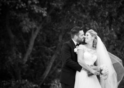 groom-hugs-bride