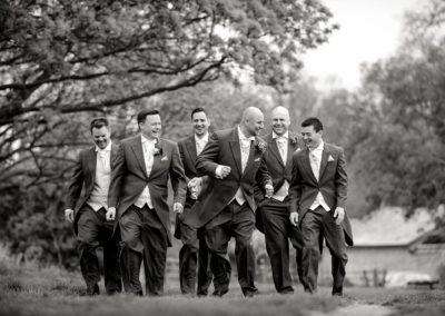 groom-with-groomsen-walking