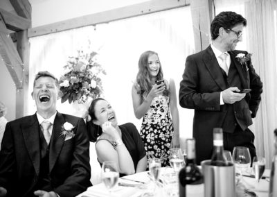 guests-laughing-at-speeches