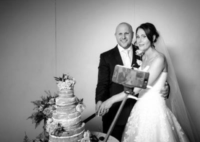 selfie-bride-and-groom-cutting-cake
