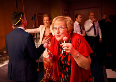 wedding-guest-eating-lolipops